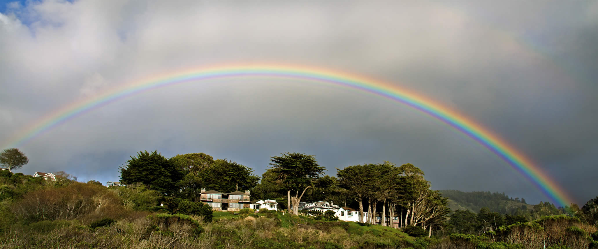 rainbow over elk cove inn on the mendocino coast
