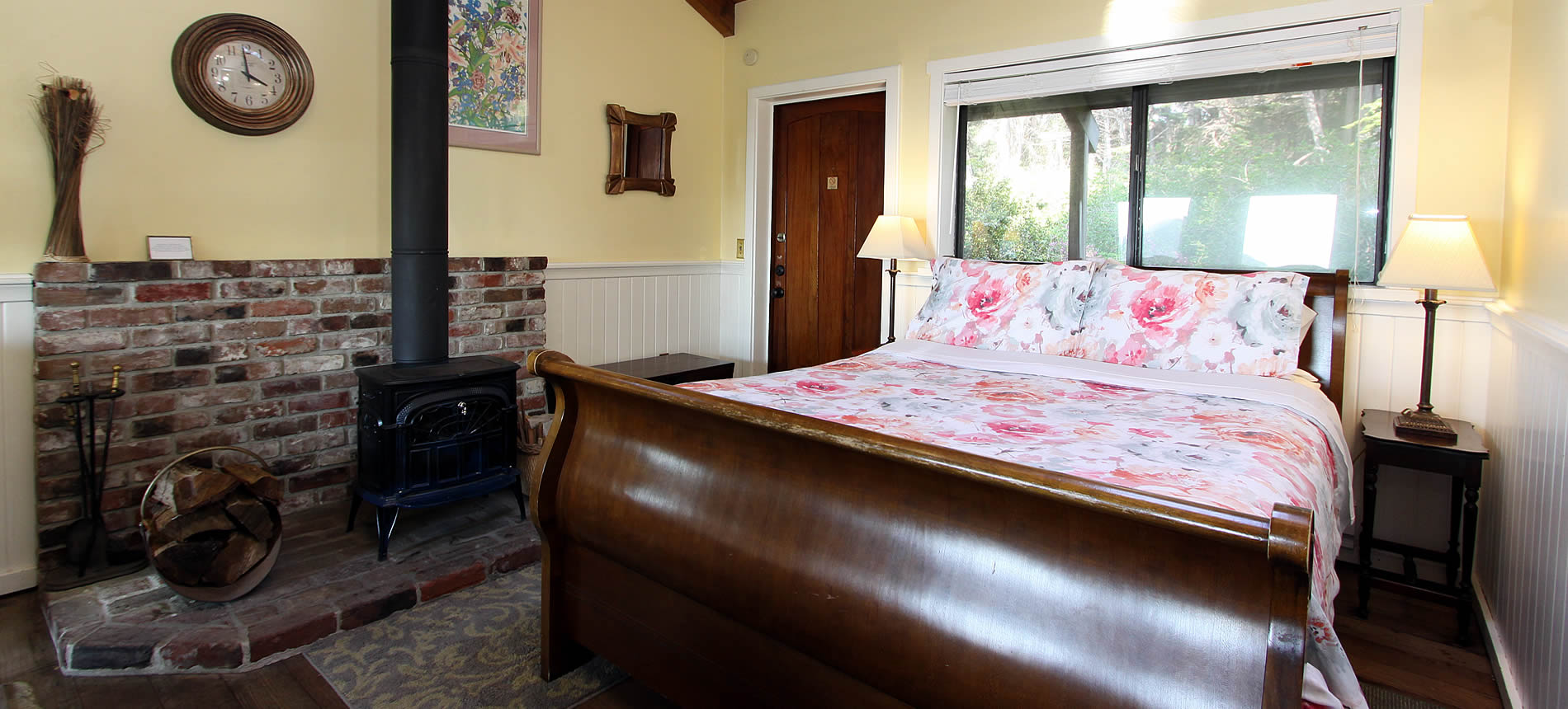 greenwood cottage with sleigh bed and wood stove